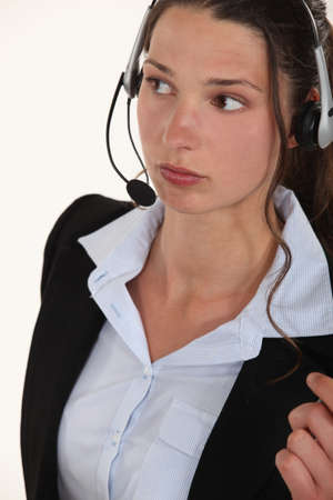 A woman with a headset on. Stock Photo - 10782706