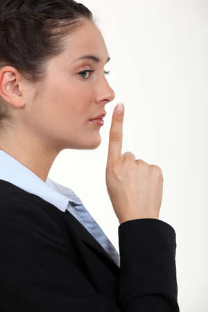 businesswoman making a sign for silence Stock Photo - 10782693