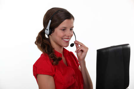 Smiling woman with a headset and laptop photo