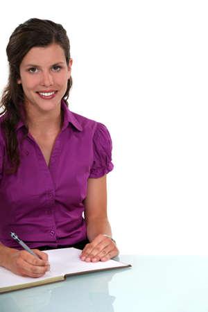 secretary desk: secretary working at her desk Stock Photo
