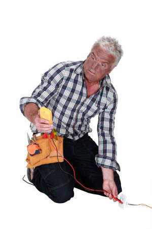 frazzled: An electrocuted tradesman staring at his multimeter
