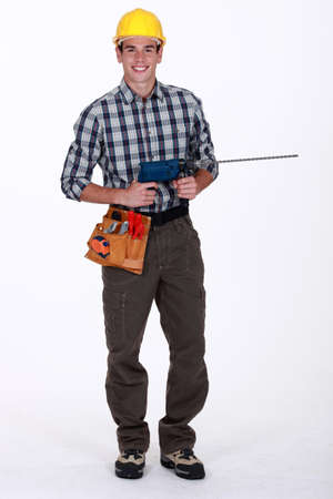 Tradesman holding a power tool photo