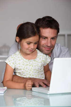 Father and daughter using a laptop Stock Photo - 10782813