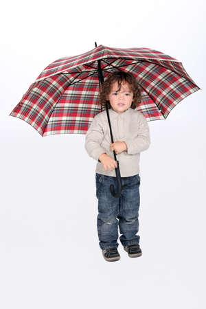 Young boy holding an open umbrella Stock Photo - 10782587