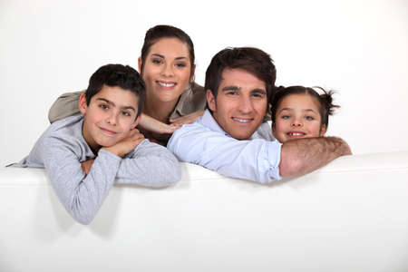 Young family with a board left blank for your image Stock Photo - 10783485