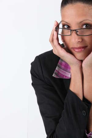 coy: Coy brunette wearing glasses Stock Photo