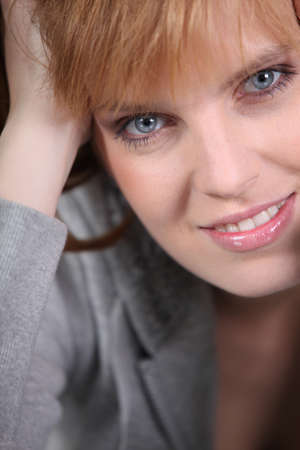 blue eyed: Portrait of redhead woman with blue eyes