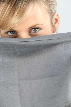 seductress: woman hiding her face
