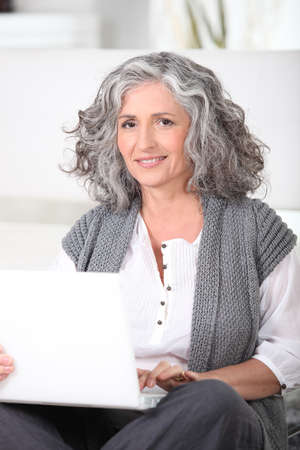 Middle-aged woman with laptop photo