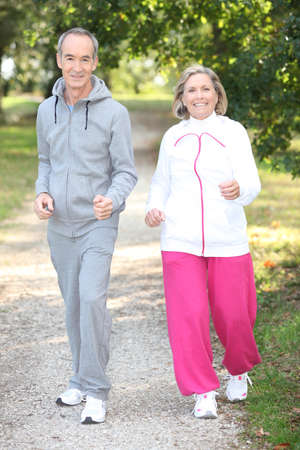 55 years old: Elderly couple jogging