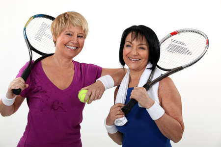 opponents: Friends playing tennis Stock Photo
