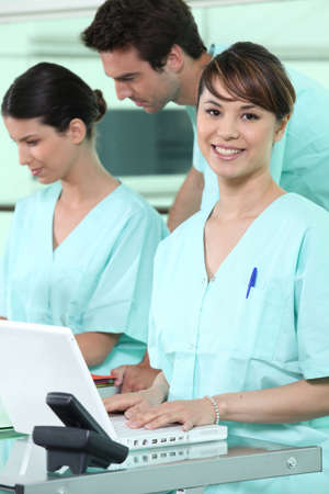 Nurses using a computer Stock Photo - 10783564