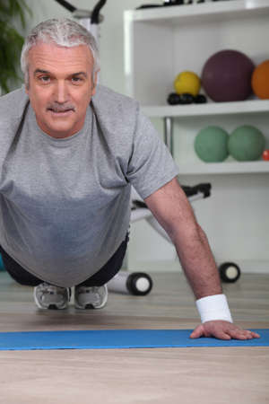 ups: Mature man doing press ups