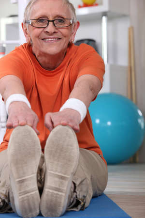 health care facility: elderly woman doing exercise