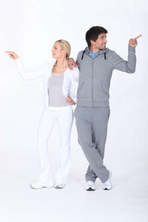 marked: a blonde woman and a man in sports wear don