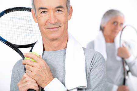 wristbands: Elderly couple playing tennis together