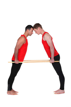 Gymnasts standing head to head photo