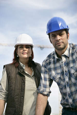 Male and female construction workers photo