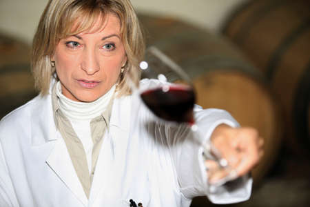 Woman at a wine tasting photo