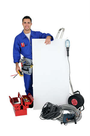Electrician on white background photo