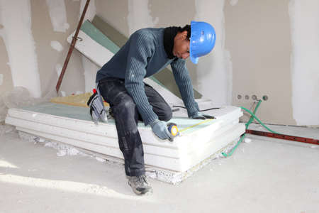gypsum: Worker using a measuring tape Stock Photo