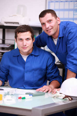 taking inventory: Two warehouse workers taking inventory Stock Photo