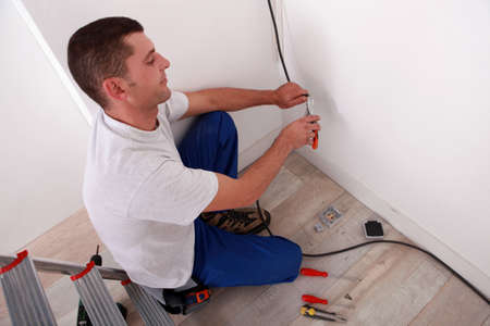 Electrician wiring a home photo