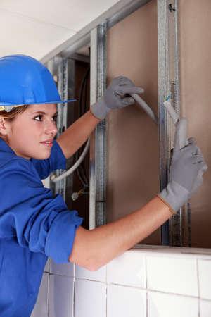 insulate: Female electrician