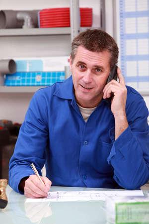 retailer: Man in a plumber Stock Photo