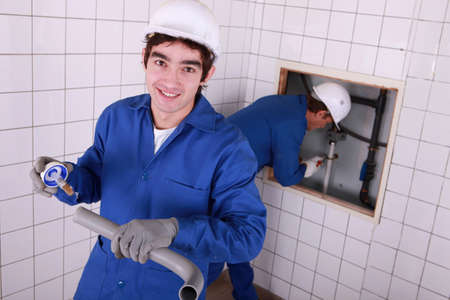 apprenticeship employee: portrait of a young plumber Stock Photo