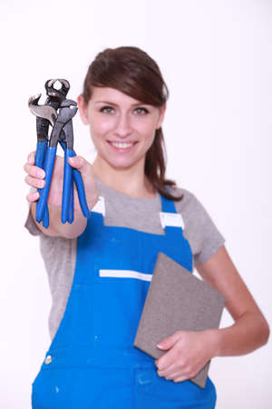 tiler: Cheerful woman in dungarees