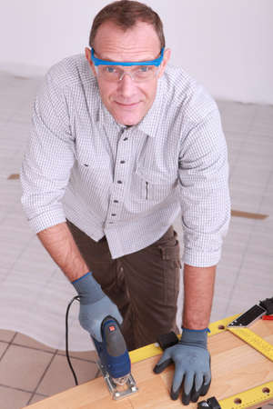 joiner laying floorboard Stock Photo - 10853551