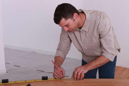 woodworker taking measurements Stock Photo