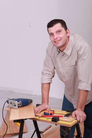 portrait of a man with electric saw photo