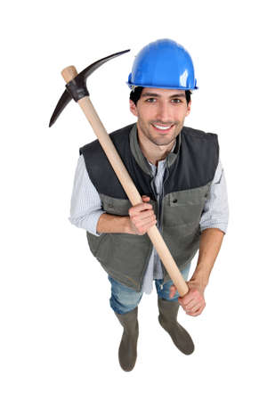 pickaxe: A manual worker with a pickaxe.