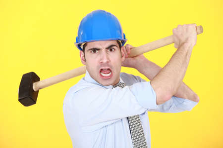 exasperate: Angry man with sledge hammer Stock Photo