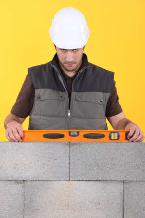 Construction worker measuring an angle with a spirit level Stock Photo - 10855061