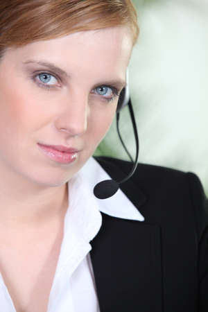 Young woman wearing a telephone headset Stock Photo - 10854183