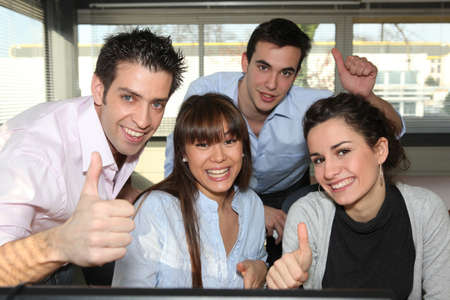 Office workers giving a thumbs up Stock Photo - 10855028
