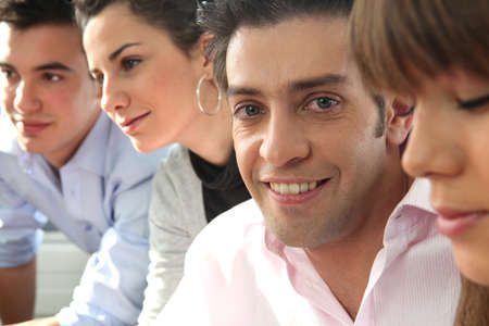 Colleagues sat in a row Stock Photo - 10853614