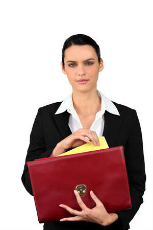 file clerks: Smart woman taking a file out of a red briefcase Stock Photo