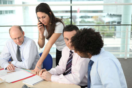 verifying: Colleagues discussing a project Stock Photo