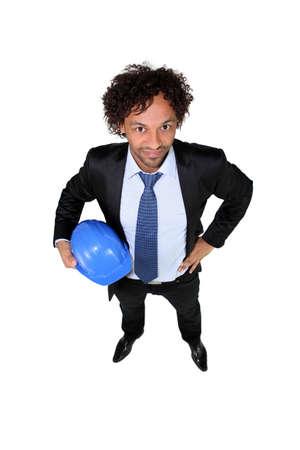 Smart entrepreneur holding hardhat Stock Photo - 10851866
