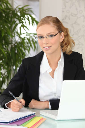rimless: pretty blonde student at work