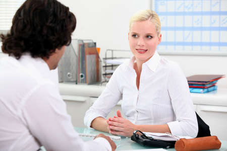 Young woman meeting employer photo