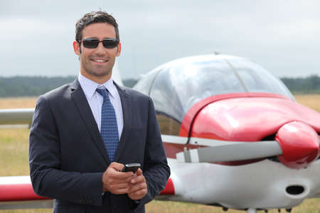Man next to a light aircraft photo