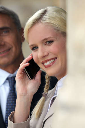Happy woman using a mobile phone Stock Photo - 10852783
