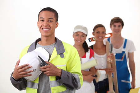 qualified worker: group of workers smiling