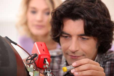 Man repairing television Stock Photo - 10852365