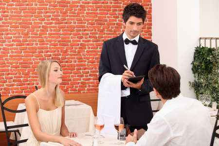 steward: Couple being served by a waiter